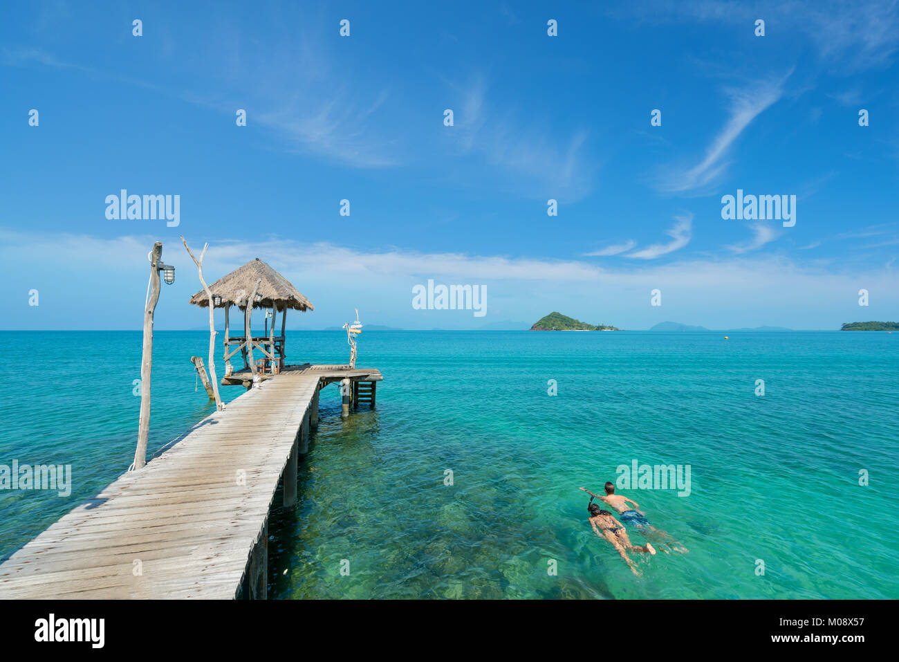 Young couple of tourists snorkel in crystal turquoise water near tropical resort in Phuket, Thailand. Summer, Vacation, - Stock Image
