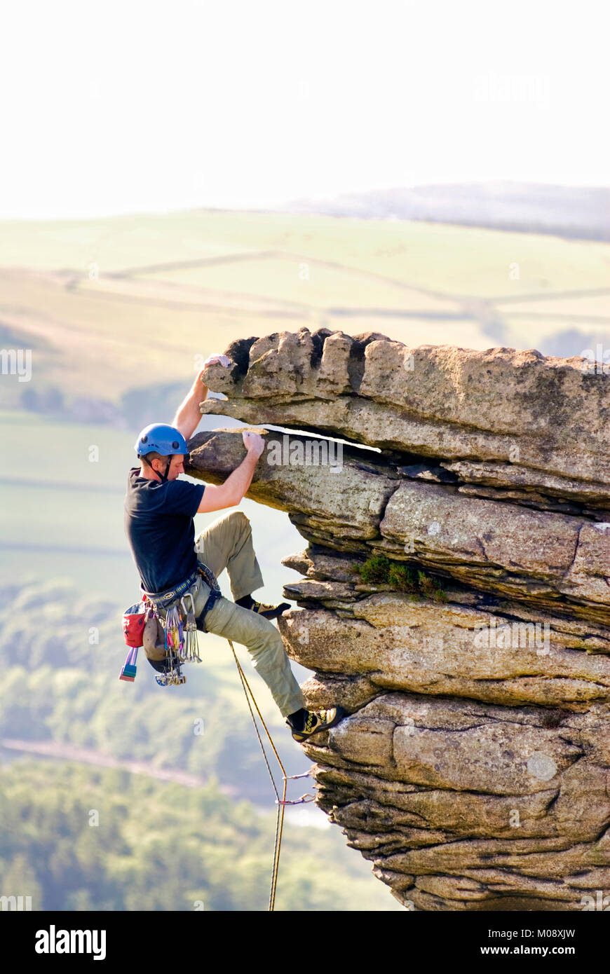 Rock climbing on Bamford Edge Peak District National Park, Derbyshire - Stock Image