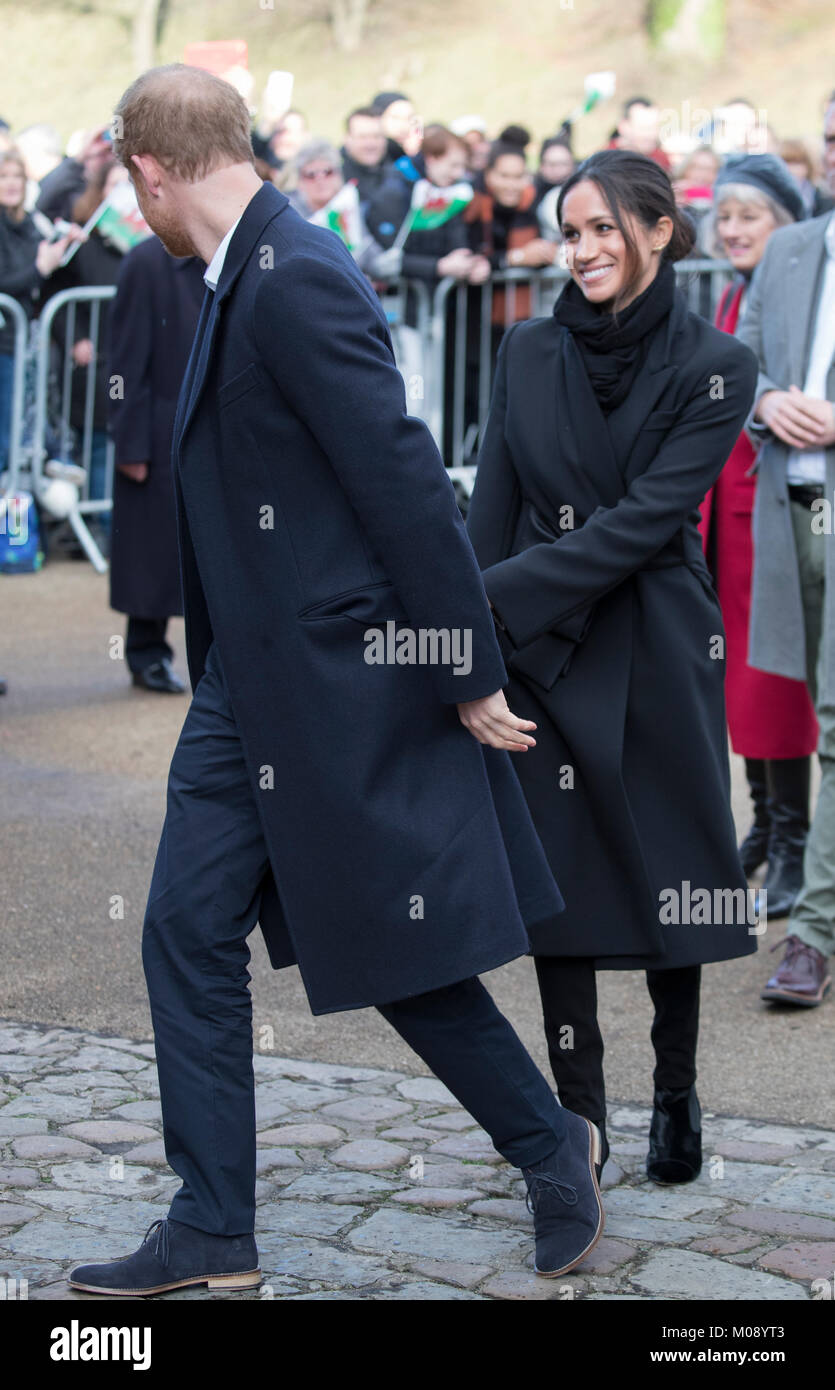 18th January 2018 Cardiff UK  Britain's Prince Harry and Meghan Markle meet the crowds waiting in the grounds of Stock Photo