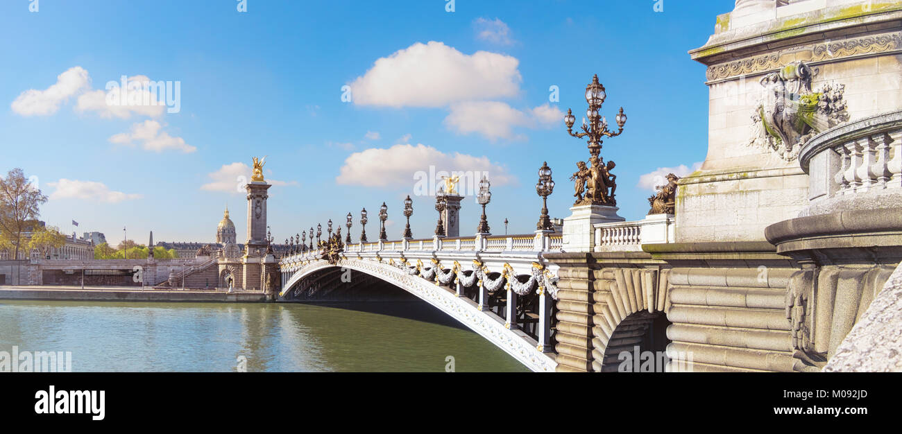 Alexandre Bridge in Paris on a bright sunny morning in Spring, toned panorama image - Stock Image