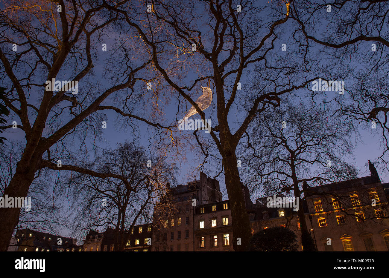 18 Jan 2018. Lumiere London, Berkeley Square, 'Was That a Dream?', a bird illuminated against the night - Stock Image