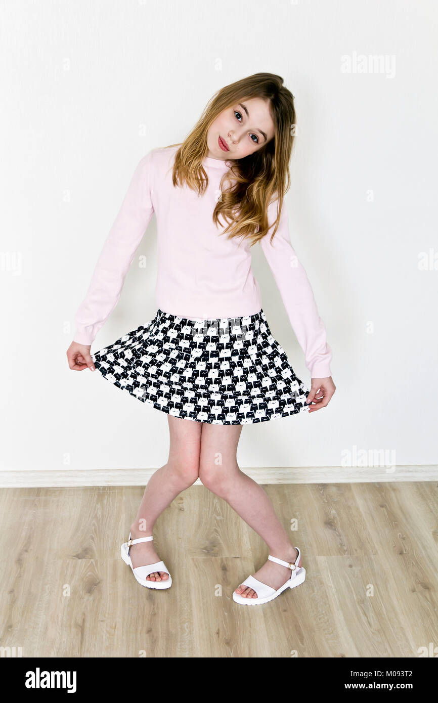 Cute girl eleven years old are dancing in empty room Stock Photo
