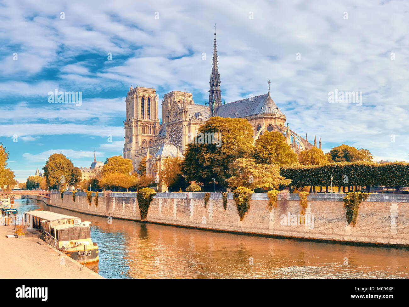 Notre Dame Cathedral in Paris on a bright day in Fall, panorama image - Stock Image