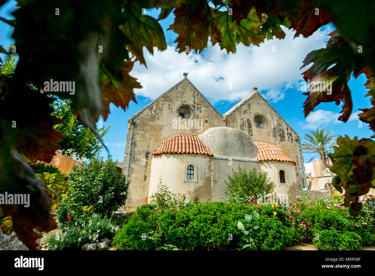 Monastery garden, Monastic Church Greek Orthodox two-nave church, National Monument of Crete in the struggle for - Stock Image