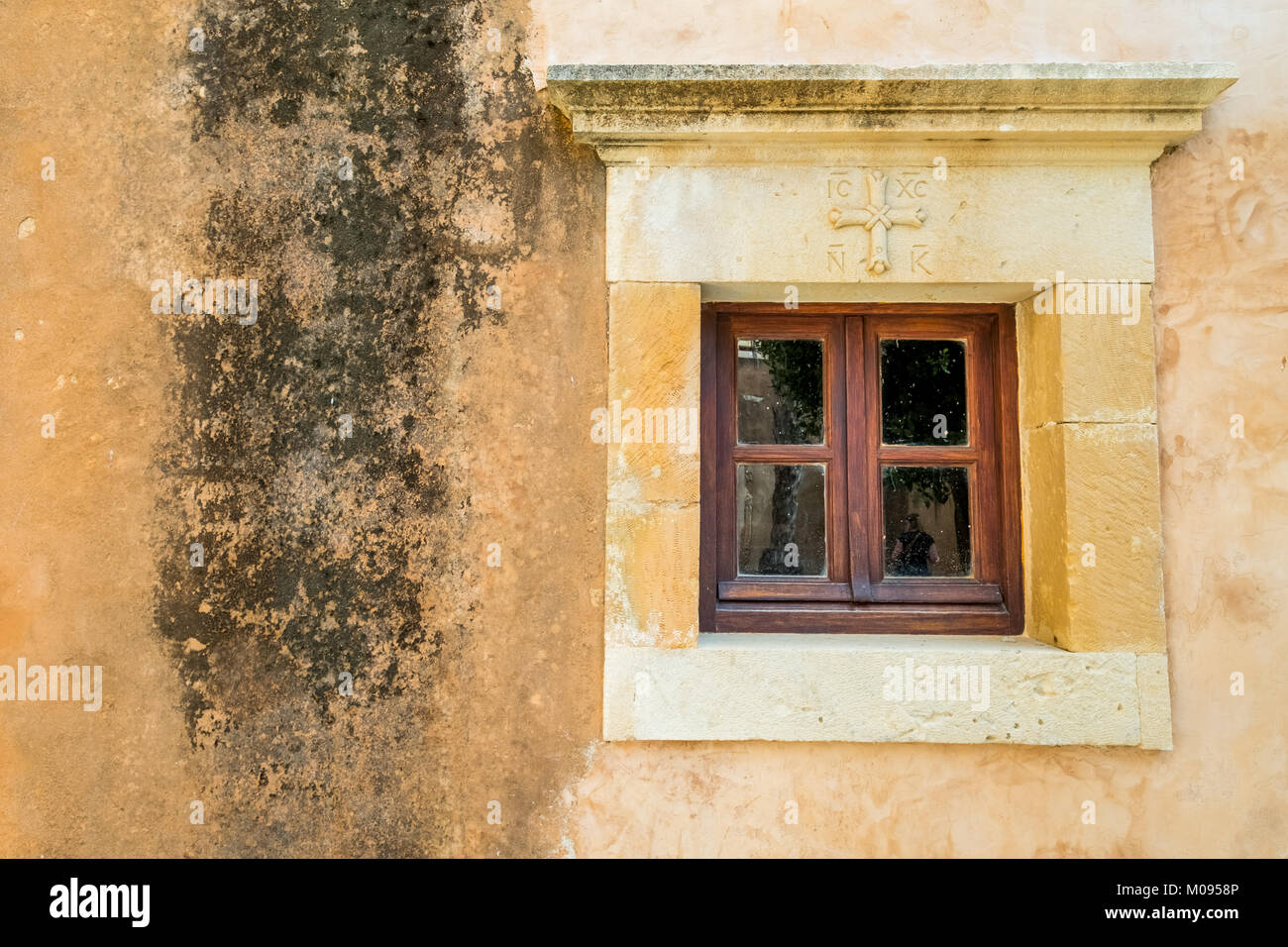 Orthodox cross window, Monastic Church Greek Orthodox two-nave church, National Monument of Crete in the struggle - Stock Image