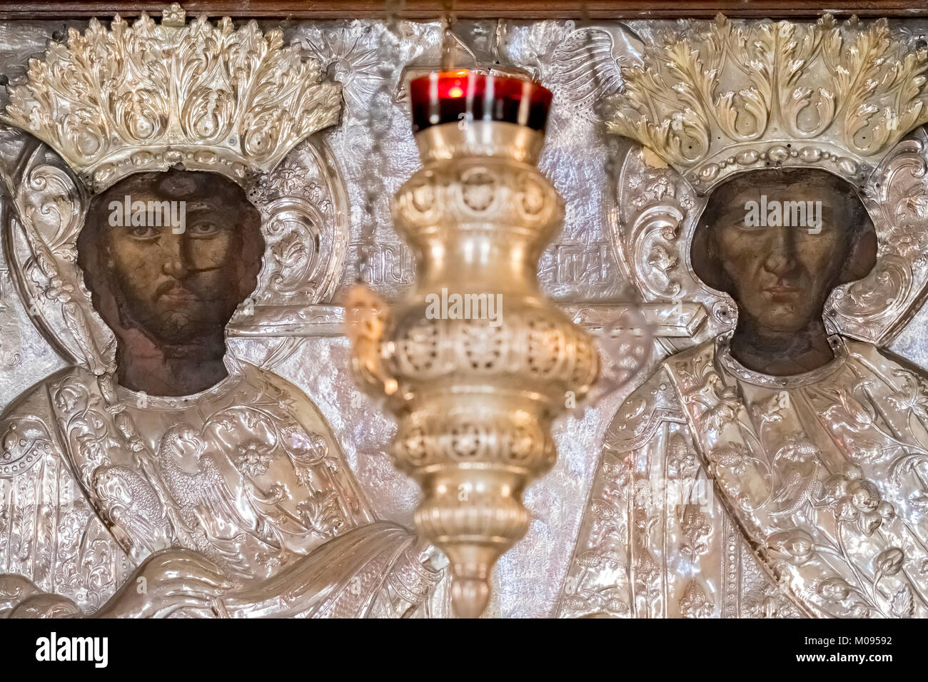 Church with images of saints, silver figures and silver chandeliers, Monastic Church Greek Orthodox two-nave church, Stock Photo