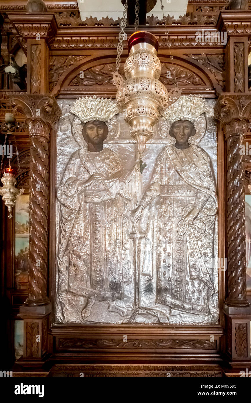 Church with images of saints, silver figures and silver chandeliers, Monastic Church Greek Orthodox two-nave church, - Stock Image