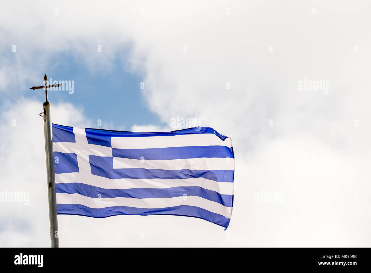 Greek flag on Moni Arkadiou Monastery with Orthodox cross,, Europe, Crete, Greece, Moni Arkadiou, Europe, Crete, - Stock Image