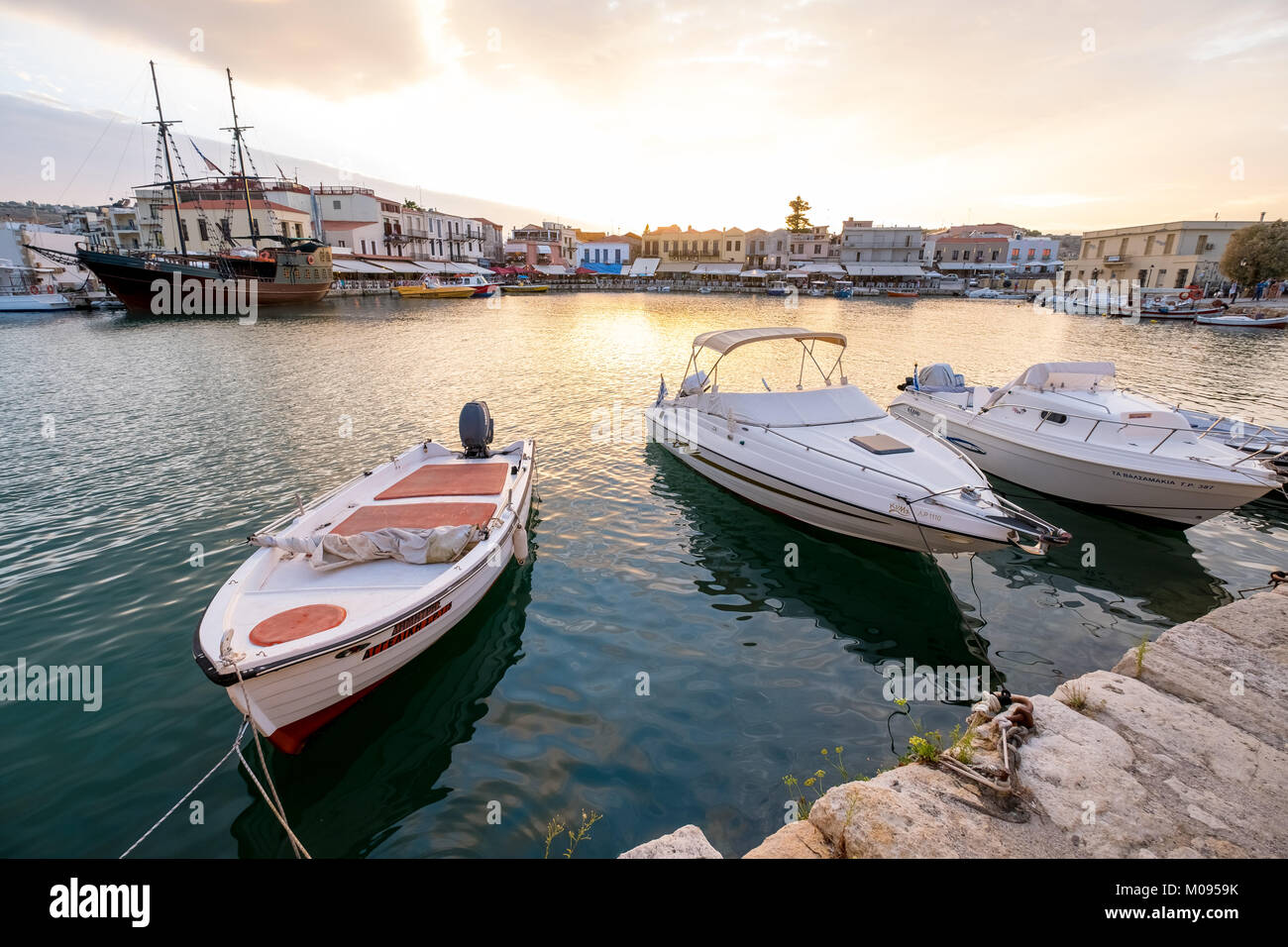 Evening mood with boats and restaurants at Venetian harbor, Rethymno, Rethimnon, Panorama, Crete, Greece, Europe, - Stock Image