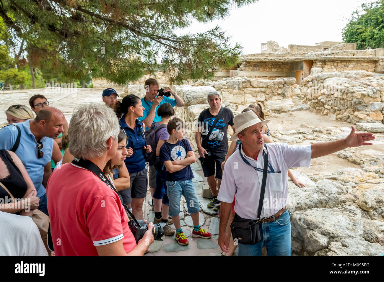 Guides before the Minoan temple complex of Knossos Palace of Knossos, ancient city of Knossos, Heraklion, Knossos, - Stock Image