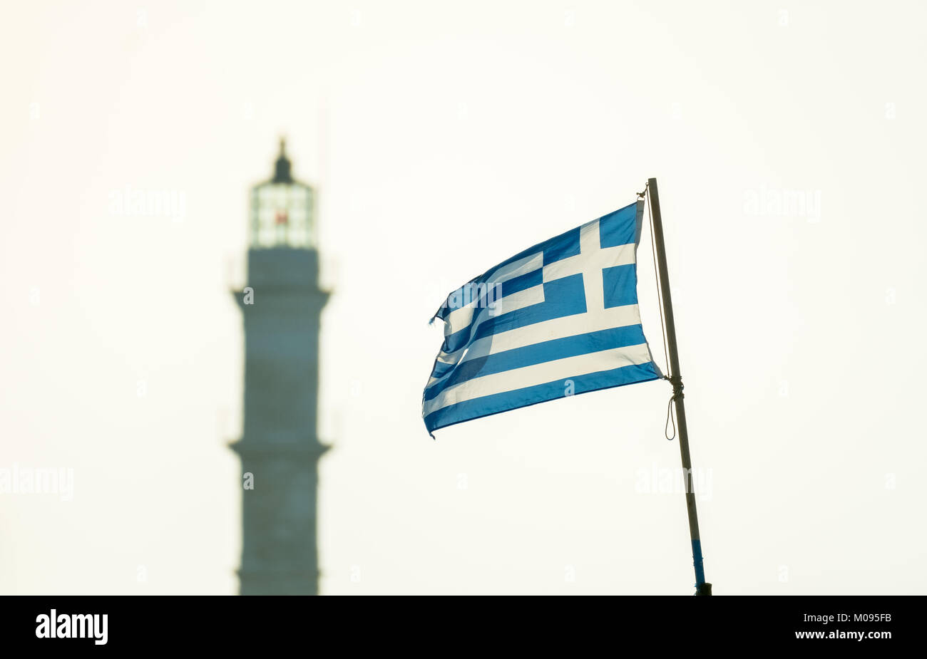 Greek flag in front of the lighthouse of Chania, Chania, Europe, Crete, Greece, Chania, Europe, Crete, Greece, GR, - Stock Image