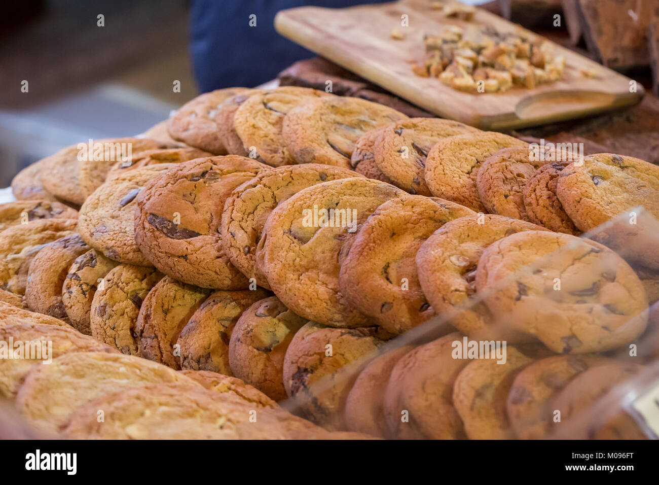 Artisan Chocolate Chip Cookies on display on a market stall in Borough Market, London - Stock Image