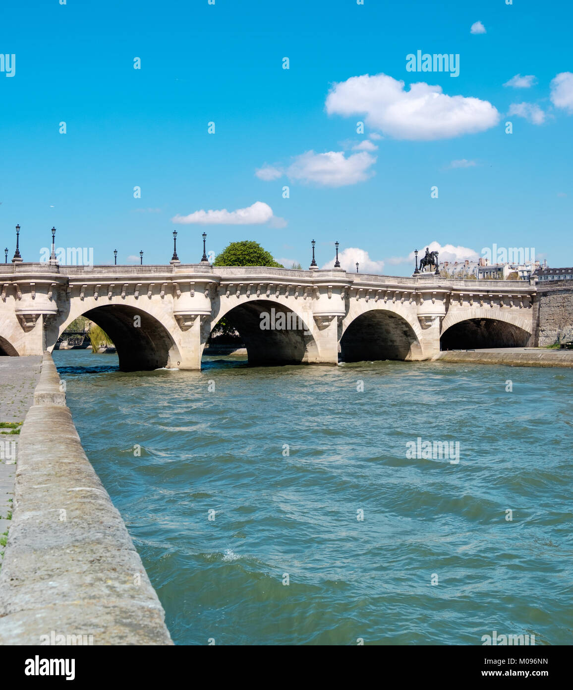 Pont Neuf bridge on Seine river in Paris, France, on a bright sunny day - Stock Image