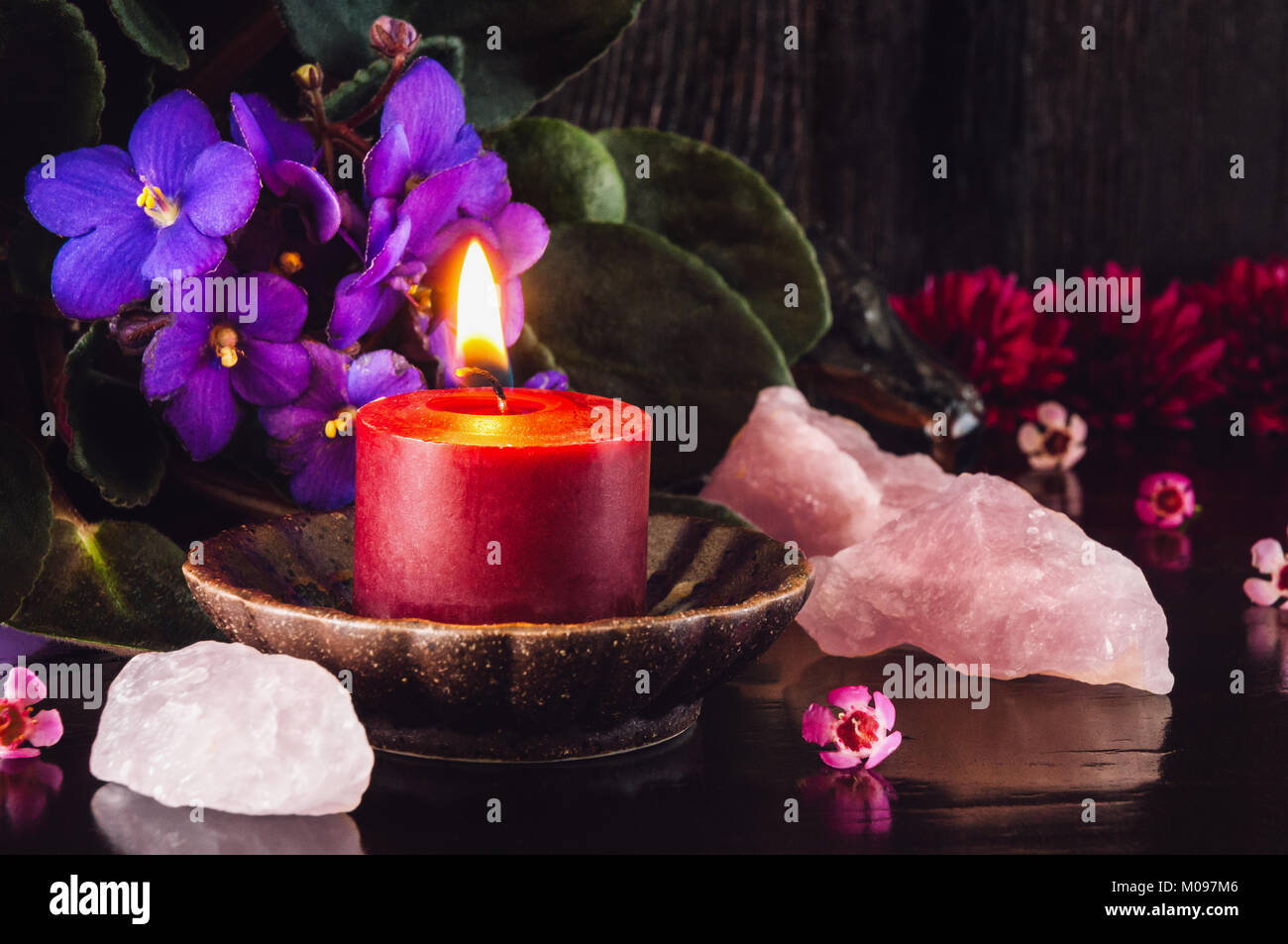 Red Candle with Rose Quartz Crystals - Stock Image