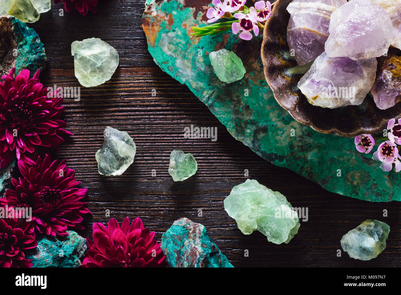 Rough Amethyst, Fluorite and Turquoise with Mixed Flowers on Dark Table Stock Photo