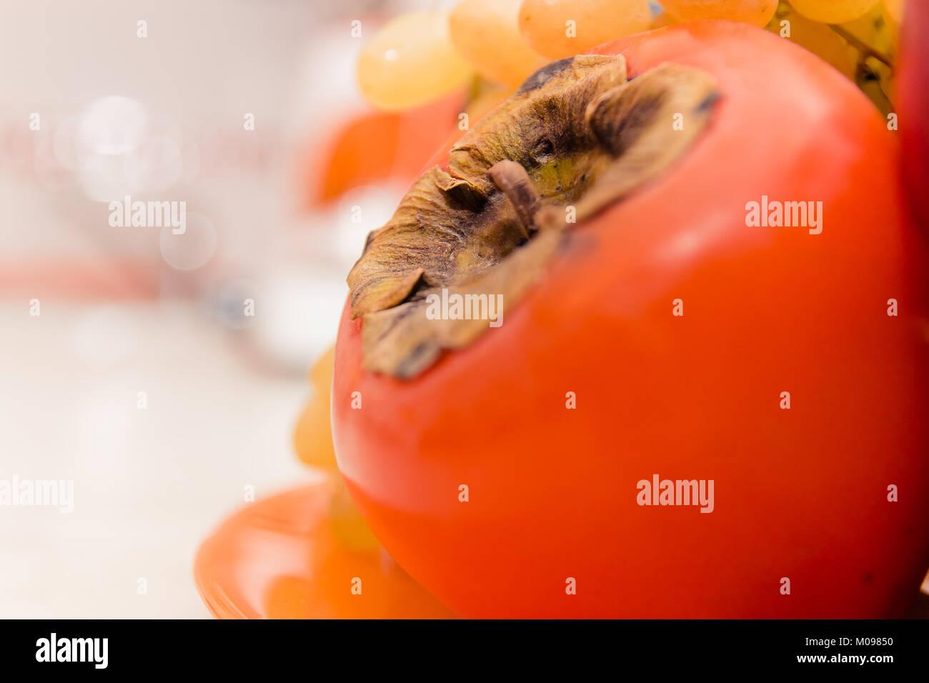 orange ripe persimmon closeup - Stock Image