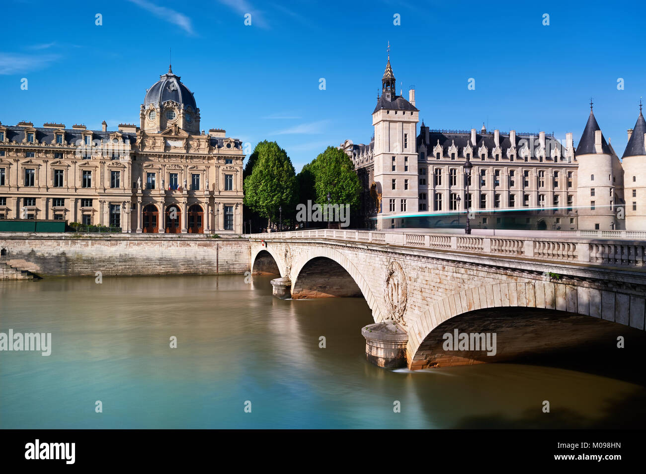 The Pont au Change connecting island Ile de la Cite with the Right Bank. Building on the left is Registry of the - Stock Image