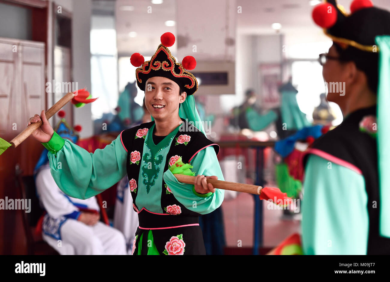 Jinan, China's Shandong Province. 19th Jan, 2018. Actors of Guzi yangge dance troupe rehearse at a culture center in Shanghe County, east China's Shandong Province, Jan. 19, 2018. Invited by the China Cultural Center in Stockholm, the troupe will participate in Spring Festival celebration events in Sweden from Feb. 9 to 14. Credit: Guo Xulei/Xinhua/Alamy Live News Stock Photo