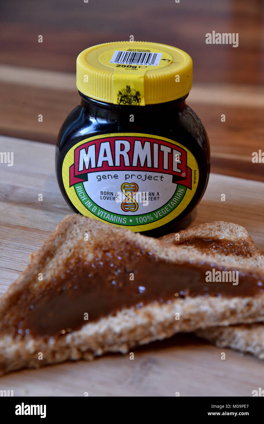 A jar of Marmite with brown bread toast - Stock Image