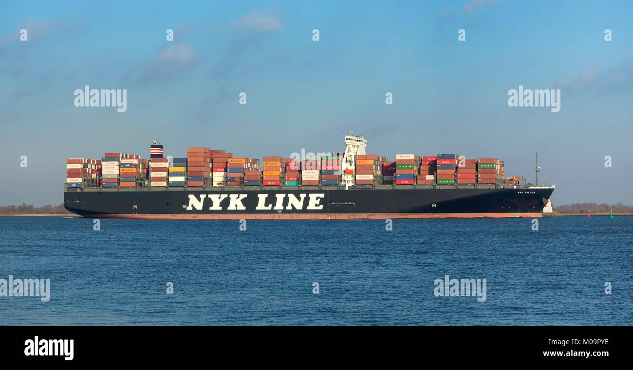 Hollern, Germany - December 29, 2017: Container ship NYK FALCON on Elbe river near Hamburg. It is owned by Japanese - Stock Image