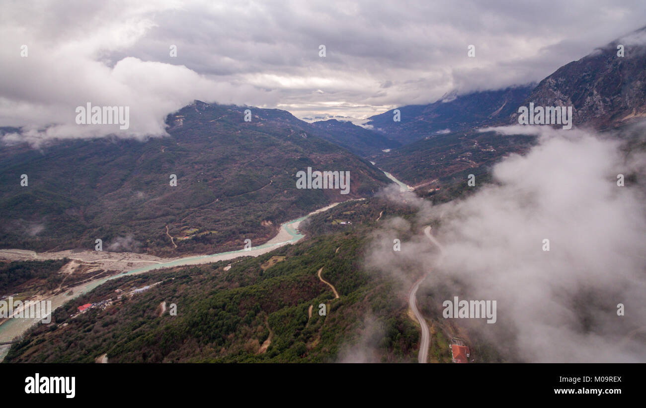 Aerial drone image of a river crossing through mountains in Tzoumerka Greece. - Stock Image