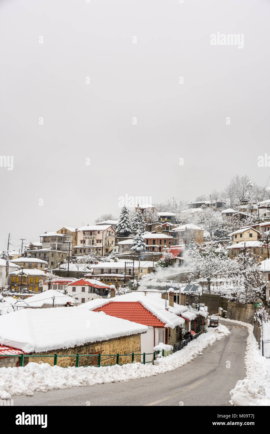 ELATI,TRIKALA/ GREECE- JANUARY 14 ,2018: Houses and streets are covered in snow from heavy snow fall in Elati ,Trikala - Stock Image