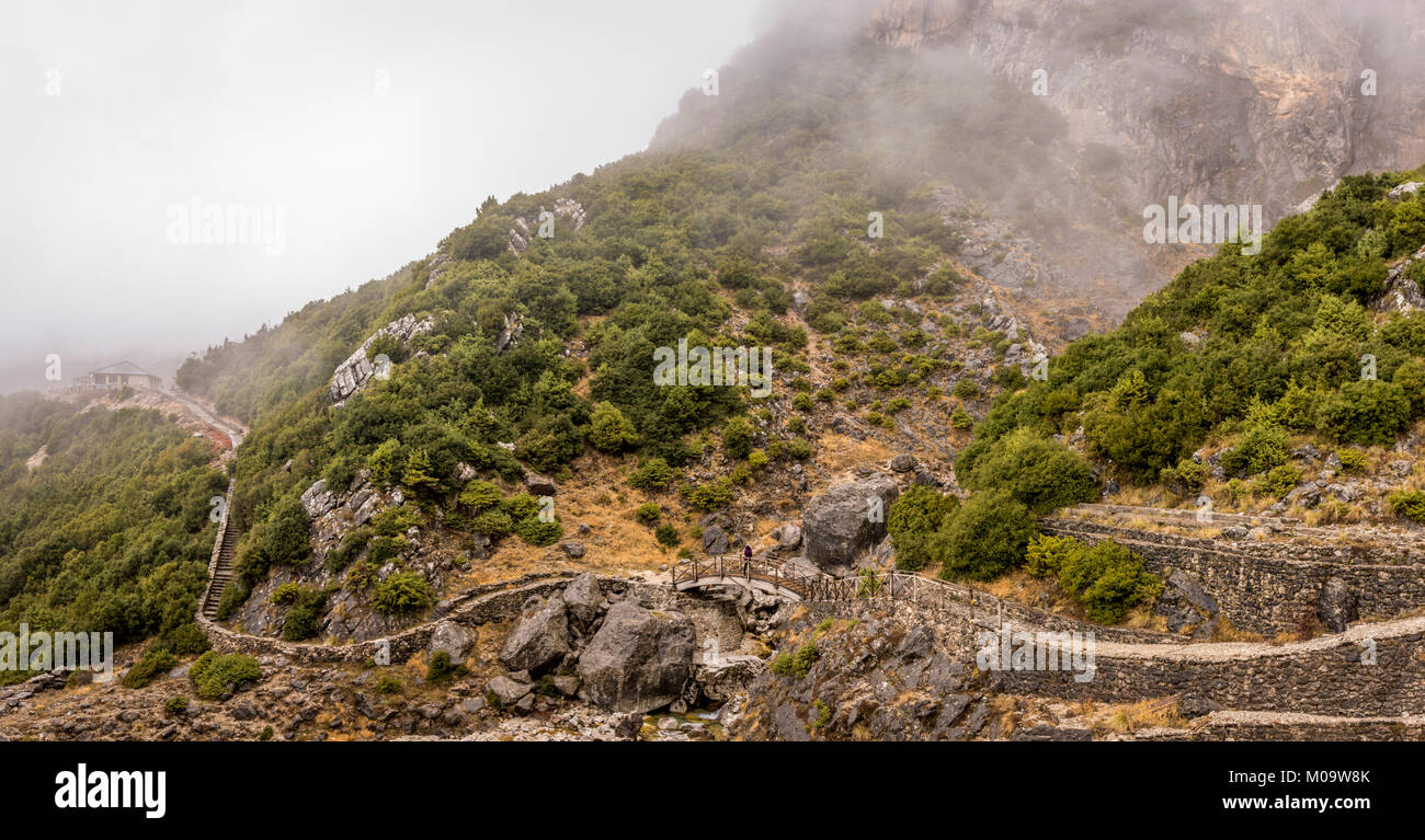 A waterfall in Tzoumerka Greece covered in fog .Low water level cause of not enough snow at the area. - Stock Image