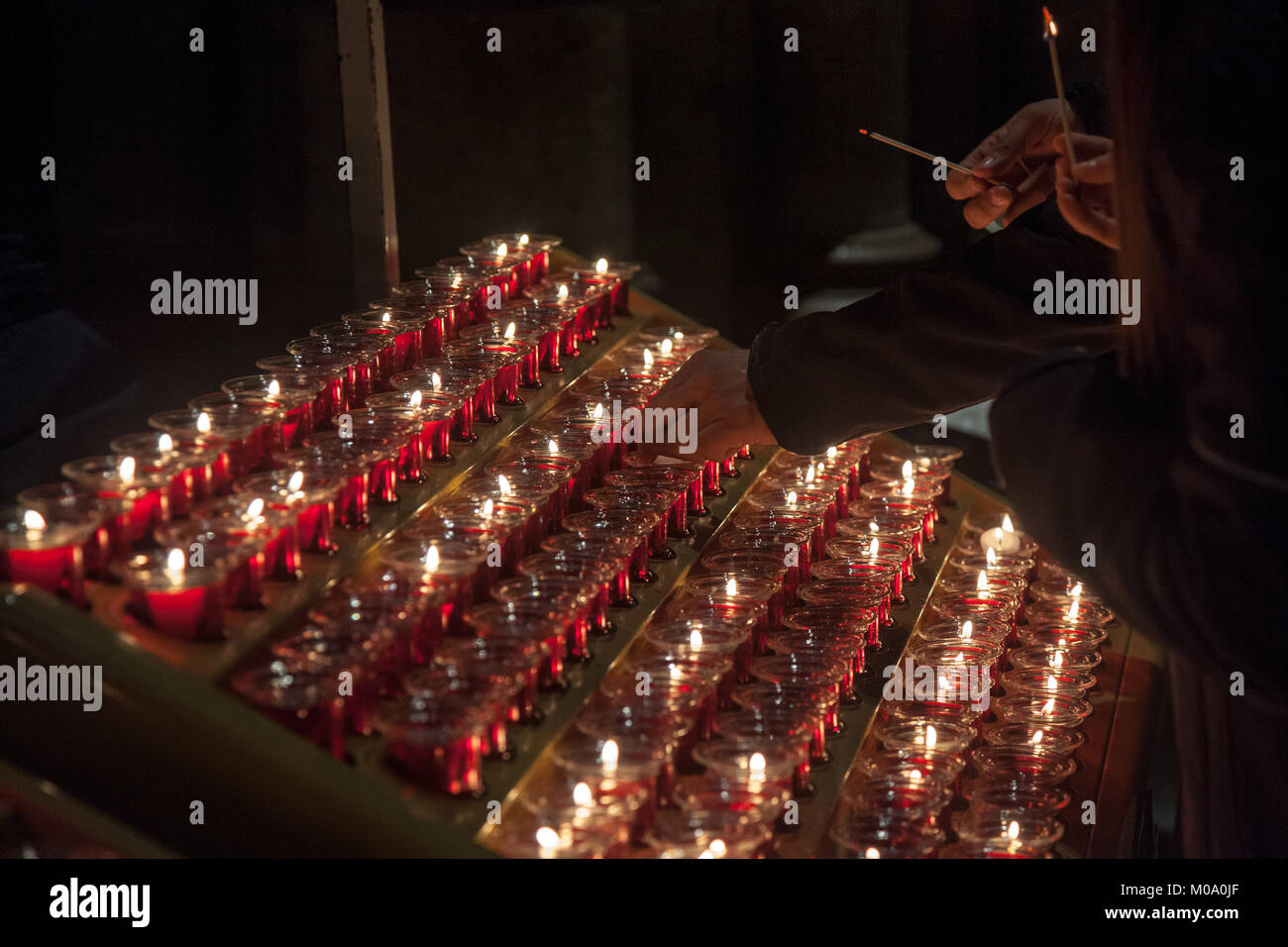 People lighting candles in the Notre Dame cathedral in Paris France. Burning a candle & Catholic Church Candle Lighting Stock Photos u0026 Catholic Church ...