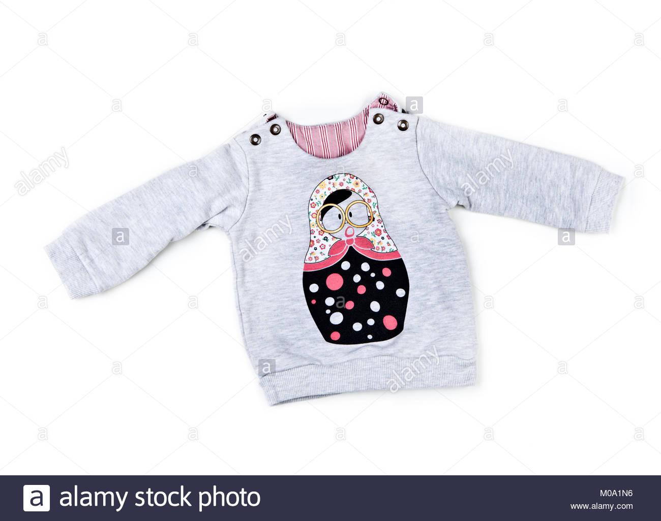 Baby Girls Warm Clothes studio quality white background - Stock Image