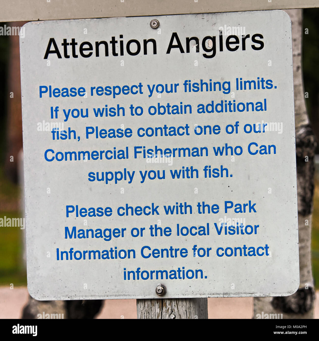 An Attention Anglers Please Respect Your Limits sign - Stock Image