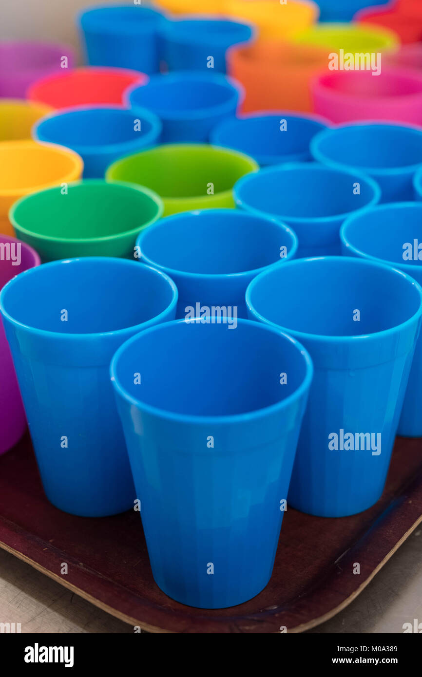 Plastic beakers and cups abstract background - Stock Image