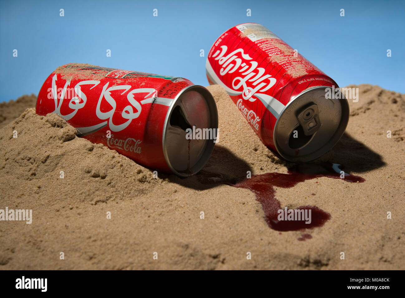 Concept image of Coke cans from Egypt and Israel - Stock Image