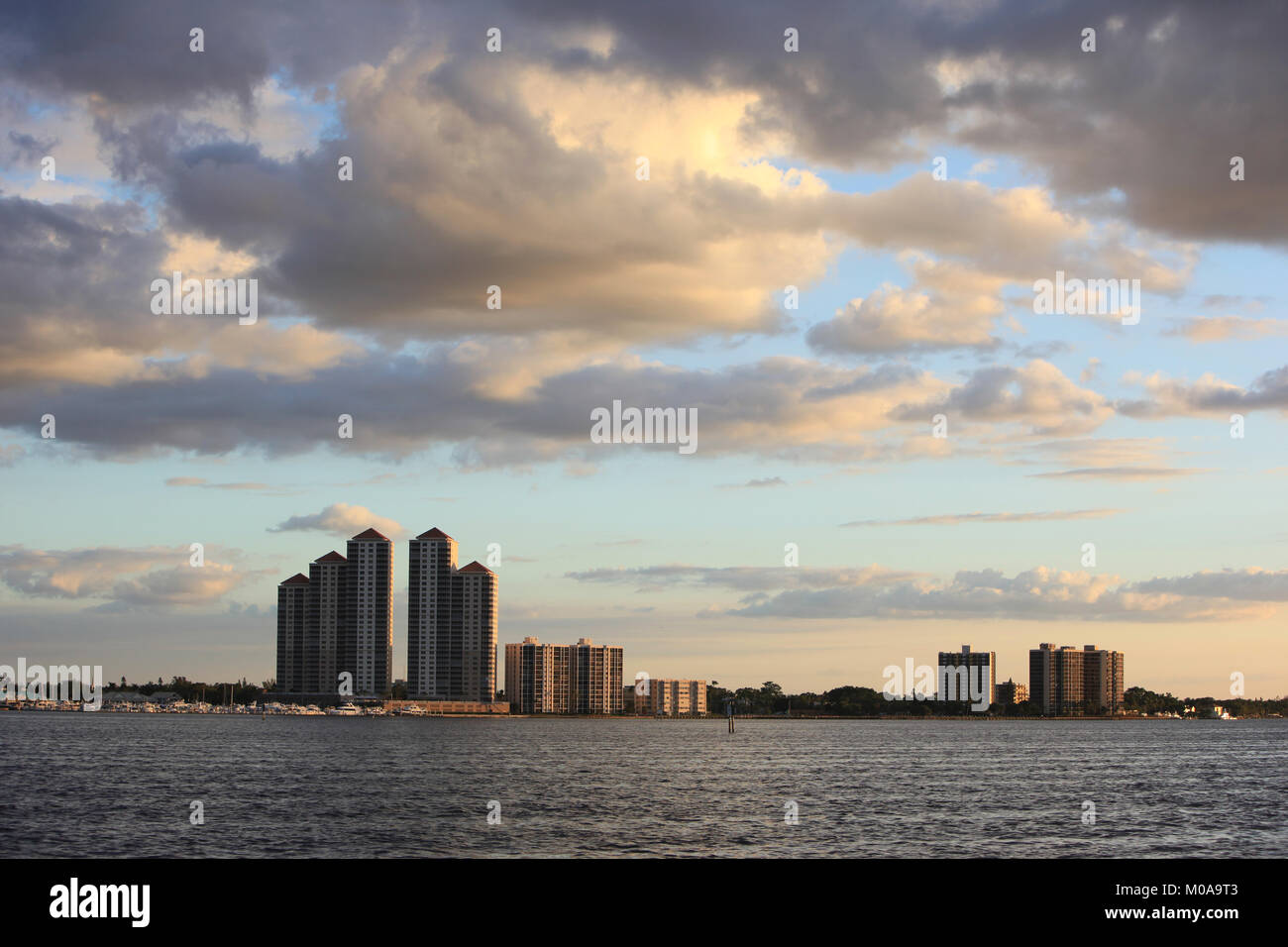 Storm clouds looming over High Point Place and various buildings along the Caloosahatchie River in Fort Myers, Florida, - Stock Image