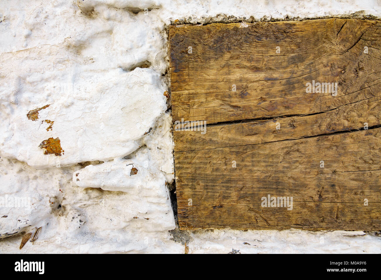 wooden joist in white wall - Stock Image