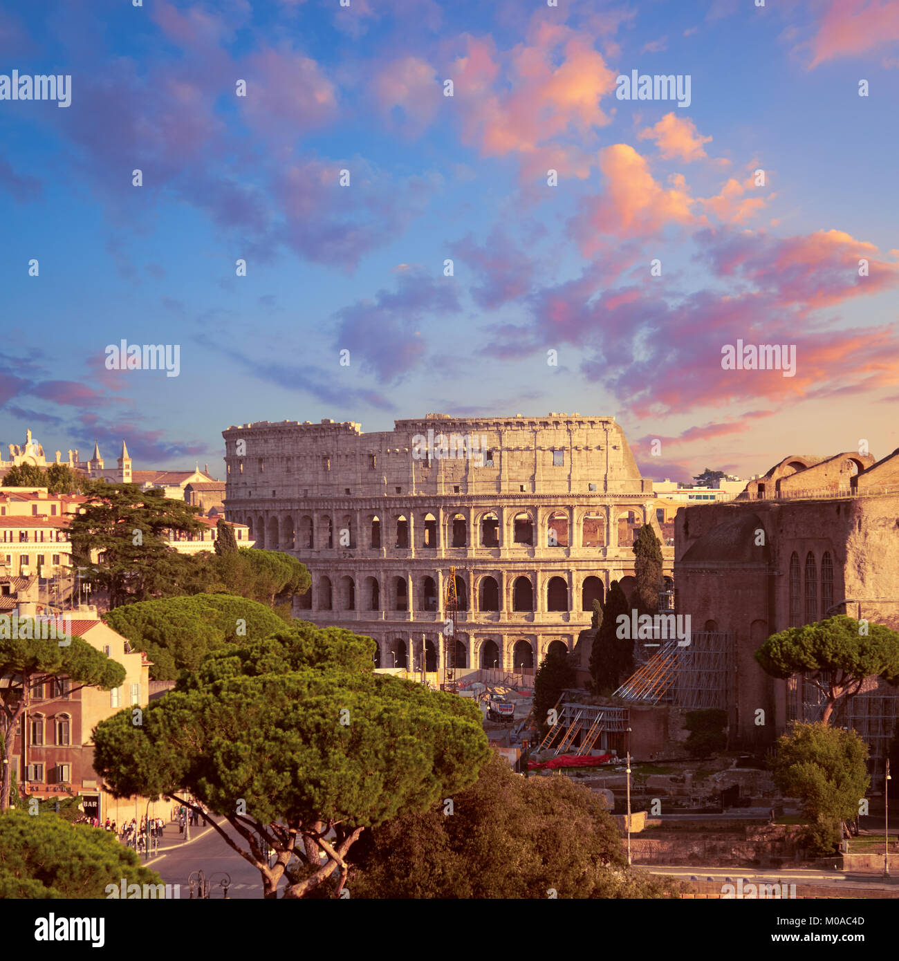 Construction work by Colosseum in Rome, Italy, on a sunset, panoramic image. Stock Photo