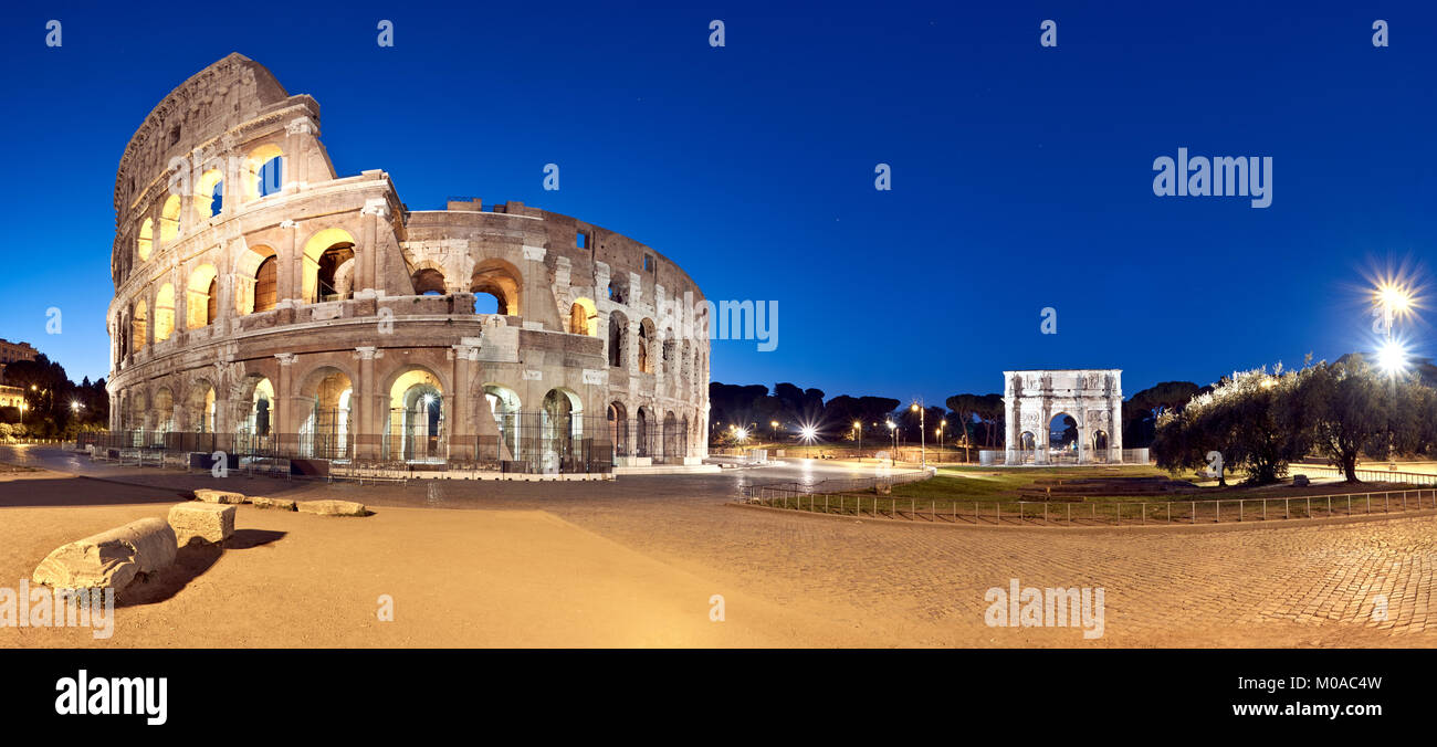Panoramic image of Colosseum (Coliseum) in Rome, Italy, at night. - Stock Image