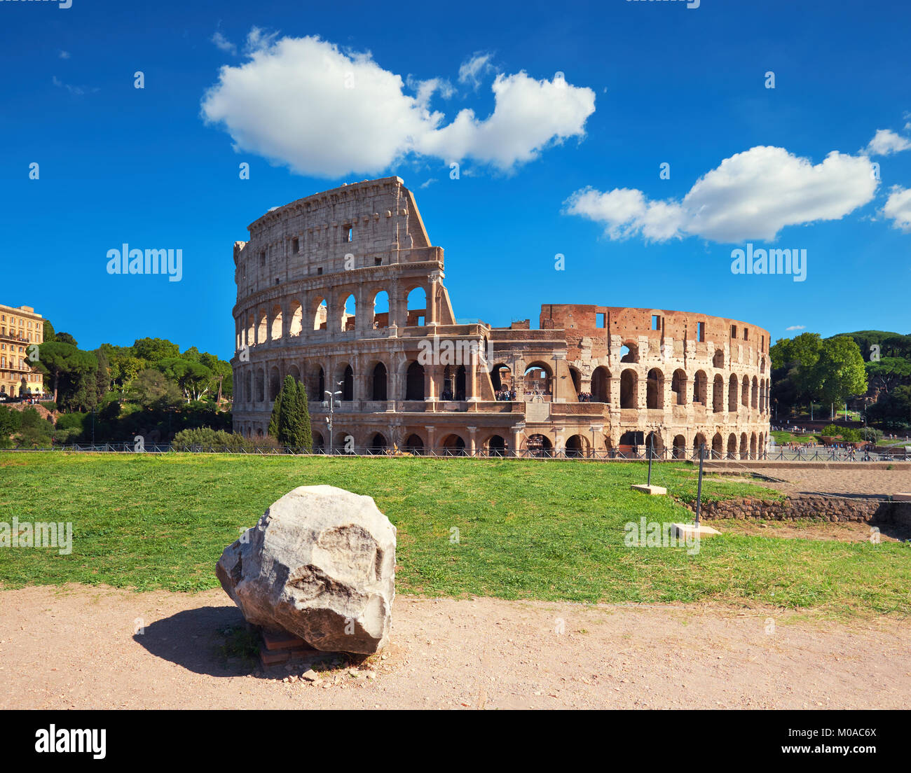 Rome, Italy. View of Colosseum from the Palatine Hill on a sunny day with blue sky and clouds. - Stock Image