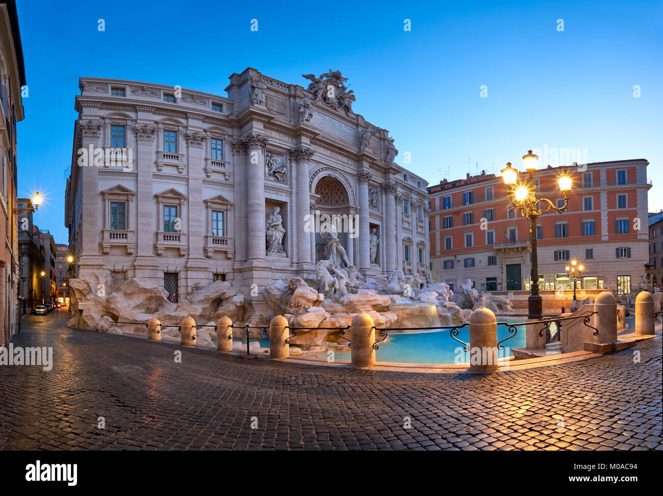 Fountain di Trevi in Rome, Italy, in the night. Panoramic image. - Stock Image