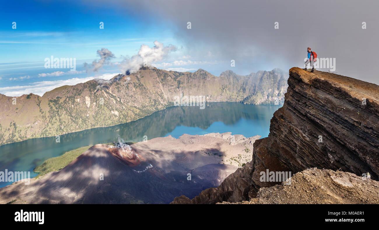 Enjoying the spectacular view of Mount Rinjani, Lombok, Indonesia - Stock Image