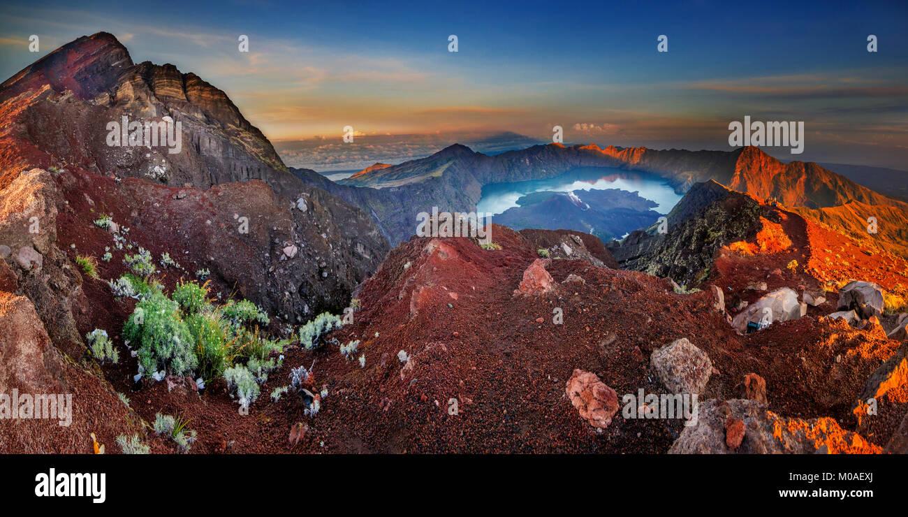 Panoramic sunrise view of Mount Rinjani, Lombok, Indonesia - Stock Image