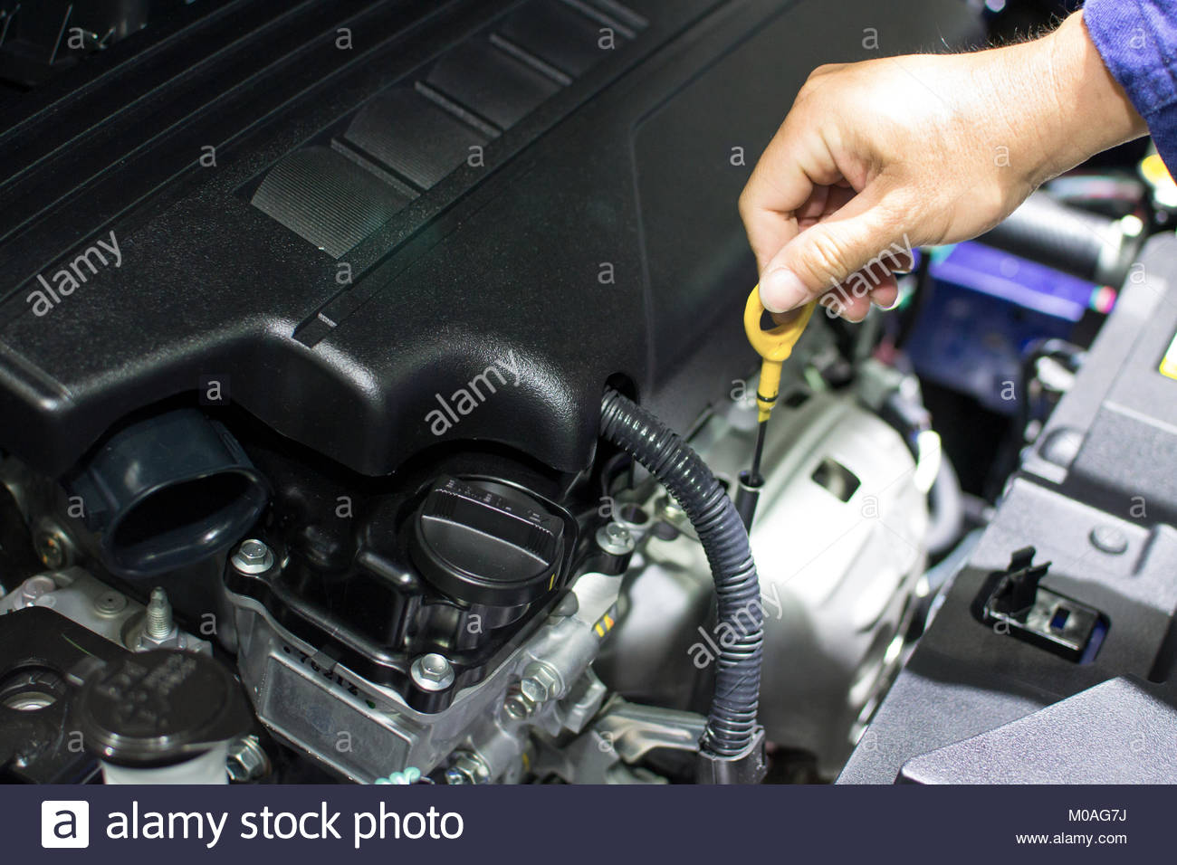 Mechanic with wrench working and repair car engine in car service centre Stock Photo