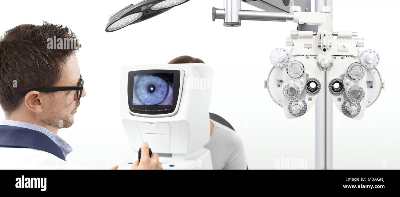optometrist examining eyesight  patient in optician office - Stock Image