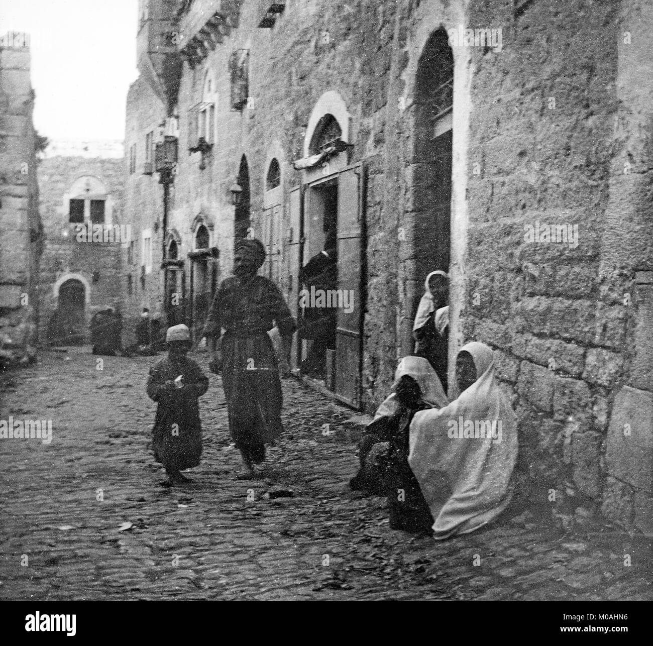 A late 19th or early 20th century black and white photograph showing a street scene in bethlehem in palestine or modern day israel