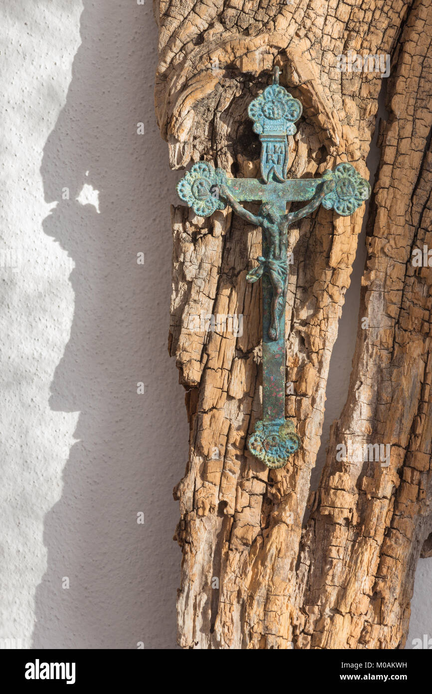 The old brass pectoral cross on the old wood. - Stock Image