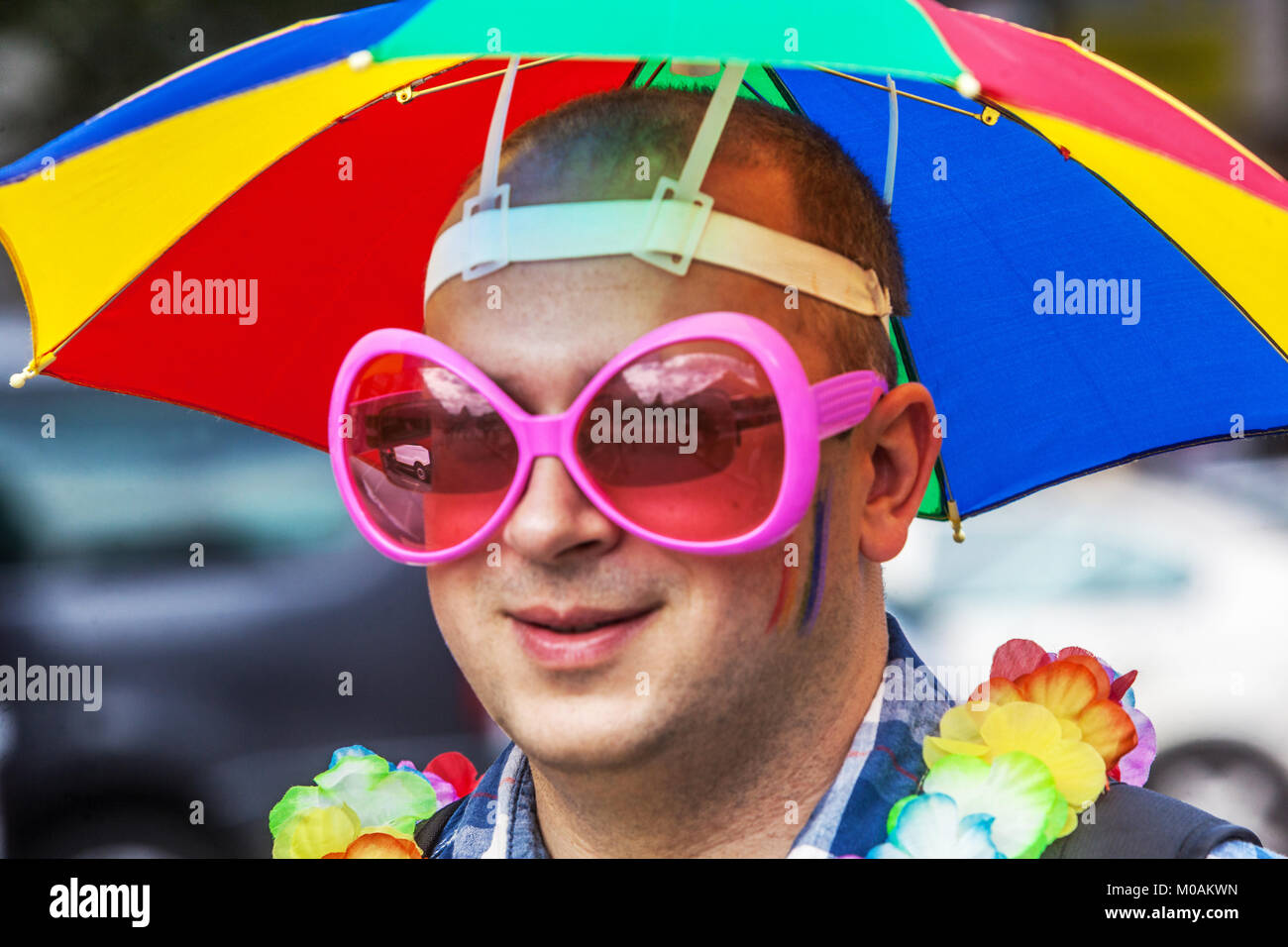 LGBT fashion, man with pink sunglasses - Stock Image