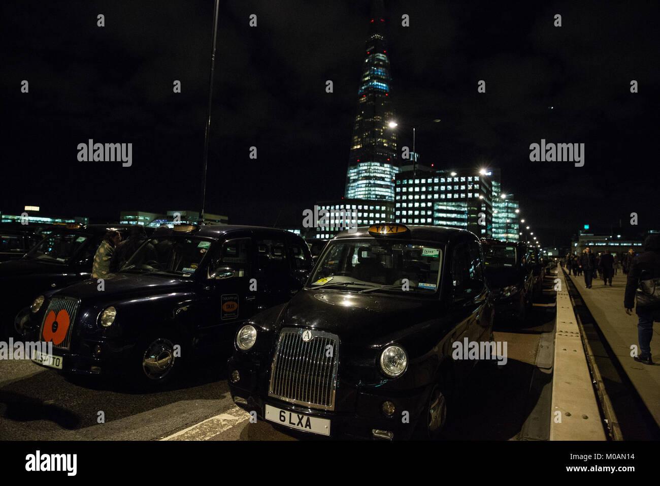 London, UK. 18th January, 2018. Black cab drivers block London Bridge at rush hour in protest at TfL's handling Stock Photo