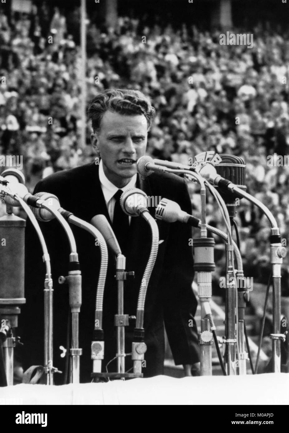 American evangelist Billy Graham addressing a crowd of over 100,000 at the Olympic Stadium in Berlin, Germany in - Stock Image