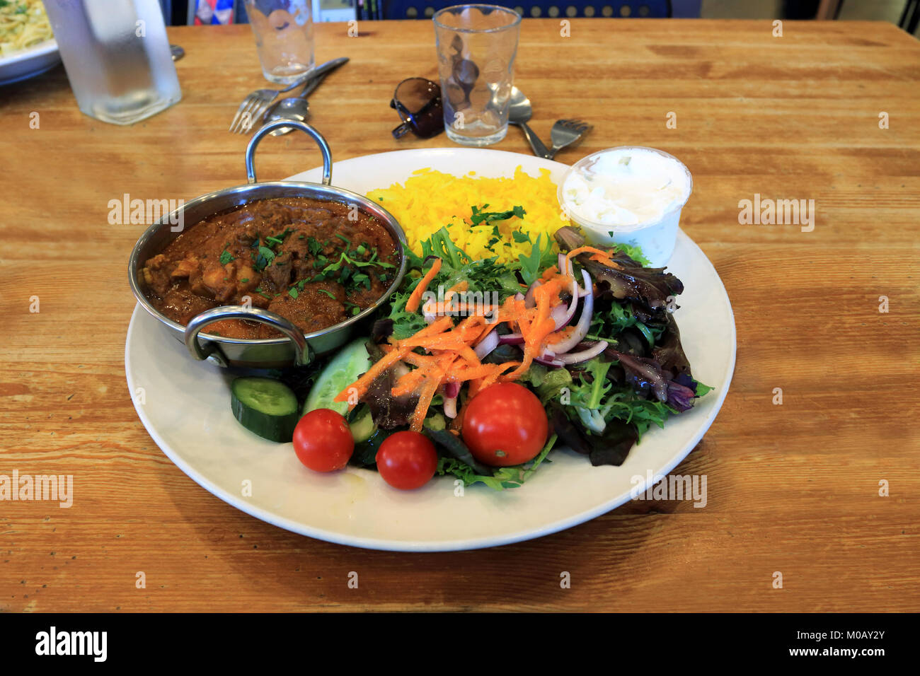 Saffron Rice With Chicken Curry And Fresh Salad And Yogurt Stock Photo Alamy