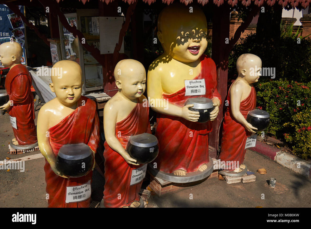 begging monk figures, Wat Chedi Luang temple and grounds, Chiang Mai, Thailand - Stock Image