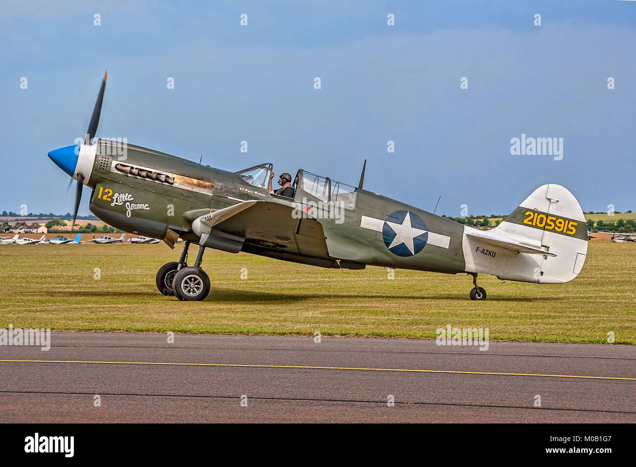 1943 P-40N Warhawk F-AZKU 'Little Jeanne' pictured taxying in at Duxford in 2011. - Stock Image